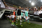 Adrien Rabiot of Paris Saint Germain and Mesut Ozil of Arsenal walk out of the tunnel during the International Champions Cup match between Arsenal and Paris Saint Germain at the National Stadium on July 28, 2018 in Singapore.