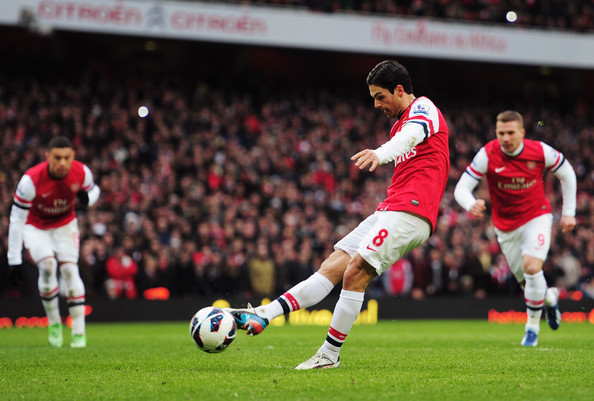 Mikel Arteta of Arsenal scores their fourth goal from the penalty spot during the Barclays Premier League match between Arsenal and Reading at Emirates Stadium on March 30, 2013 in London, England.