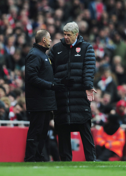 Arsene Wenger manager of Arsenal protests to fourth official Mark Halsey during the Barclays Premier League match between Arsenal and Reading at Emirates Stadium on March 30, 2013 in London, England.