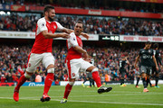 Santi Cazorla of Arsenal (C) celebrates scoring his sides second goal with Olivier Giroud of Arsenal (L) during the Premier League match between Arsenal and Southampton at Emirates Stadium on September 10, 2016 in London, England.