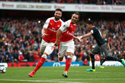 Santi Cazorla of Arsenal celebrates scoring his sides first goal with Olivier Giroud of Arsenal during the Premier League match between Arsenal and Southampton at Emirates Stadium on September 10, 2016 in London, England.