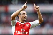 Santi Cazorla of Arsenal celebrates scoring his sides second goal during the Premier League match between Arsenal and Southampton at Emirates Stadium on September 10, 2016 in London, England.