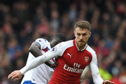 Badou Ndiaye of Stoke City is challenged by Aaron Ramsey of Arsenal during the Premier League match between Arsenal and Stoke City at Emirates Stadium on April 1, 2018 in London, England.