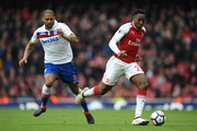Danny Welbeck of Arsenal gets away from Glen Johnson of Stoke City during the Premier League match between Arsenal and Stoke City at Emirates Stadium on April 1, 2018 in London, England.