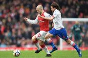 Jack Wilshere of Arsenal is challenged by Joe Allen of Stoke City during the Premier League match between Arsenal and Stoke City at Emirates Stadium on April 1, 2018 in London, England.