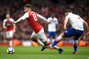 Erik Pieters of Stoke City fouls Aaron Ramsey of Arsenal during the Premier League match between Arsenal and Stoke City at Emirates Stadium on April 1, 2018 in London, England.