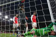 Petr Cech of Arsenal signals for Steven Fletcher of Sunderland to receive medical treatment during the Barclays Premier League match between Arsenal and Sunderland at Emirates Stadium on December 5, 2015 in London, England.