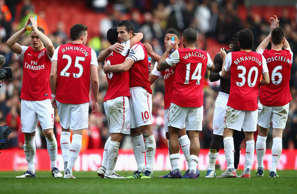 Robin van Persie of Arsenal celebrates with team mates after the Barclays Premier League match between Arsenal and <a href=