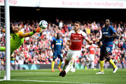 Aaron Ramsey of Arsenal shoots and misses past Lukasz Fabianski of West Ham United during the Premier League match between Arsenal FC and West Ham United at Emirates Stadium on August 25, 2018 in London, United Kingdom.