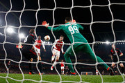 Aaron Ramsey of Arsenal heads at goal which is saved and leads to Danny Welbeck's goal during the UEFA Europa League Round of 16 match between Arsenal and AC Milan at Emirates Stadium on March 15, 2018 in London, England.
