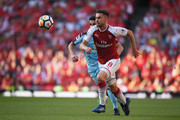 Aaron Ramsey of Arsenal in action during the Premier League match between Arsenal and Burnley at Emirates Stadium on May 6, 2018 in London, England.