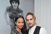 Zoe Saldana and Marco Perego attend The Art of Elysium celebrates the work of Jared Lehr at The Talmadge on December 1, 2015 in Los Angeles, California.