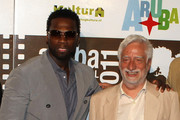 """50 Cent and Claudio Masenza attends the premiere of """"Things Fall Apart"""" at the Aruba Film Festival on June 14, 2011 in Aruba, Aruba."""