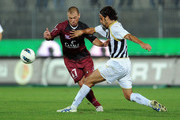 Alessio Campagnacci of Reggina and Gianluca Giovannini of Ascoli in action during the Serie B match between Ascoli Calcio and Reggina Calcio at Stadio Cino e Lillo Del Duca on October 5, 2011 in Ascoli Piceno, Italy.