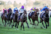 Paul Hanagan riding Sands Of Mali (C, purple cap) win The Qipco British Champions Sprint Stakes at Ascot Racecourse on October 20, 2018 in Ascot, United Kingdom.