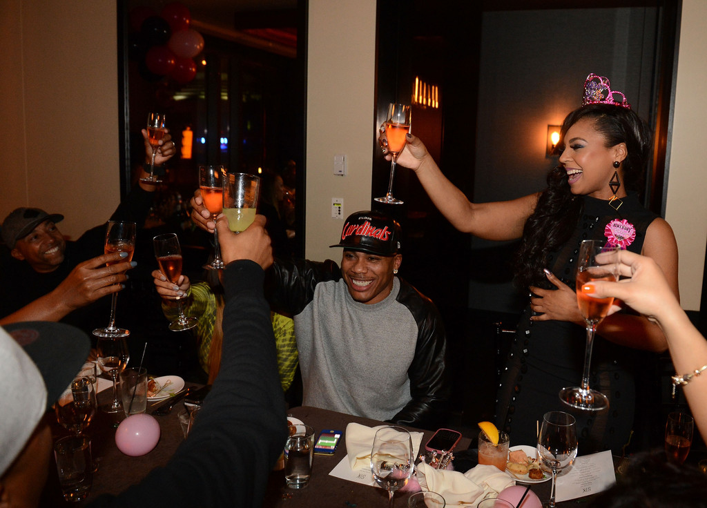 Ashanti and Nelly during Ashantis 25th Birthday Surprise