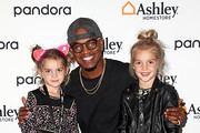 (L-R) Mila Stauffer, Ne-Yo and Emma Stauffer attend Ashley HomeStore Presents Urbanology Powered By Pandora Featuring Ne-Yo at Goya Studios on October 05, 2019 in Los Angeles, California.