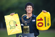 Chang-Won Han of South Korea poses with the trophy after winning the Asian Amateur Championship at the Mission Hills Golf Club on November 1, 2009 in Shenzhen, Guangdong, China. Chang-Won Han wins a place at the 2010 Masters Tournament and International Final Qualifying for the 150th Open Championship at St Andrews