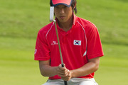 Chang-Won Han of South Korea lines up a putt on the 15th hole during the day three of Asian Amateur Championship at the Mission Hills Golf Club on October 31, 2009 in Shenzhen, Guangdong, China.
