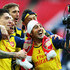 Santi Cazorla Nacho Monreal Photos - (L-R) Hector Bellerin, Laurent Koscielny, Nacho Monreal, Alex Oxlade-Chamberlain and Santi Cazorla use a photographers camera as they celebrate victory after the FA Cup Final between Aston Villa and Arsenal at Wembley Stadium on May 30, 2015 in London, England. Arsenal beat Aston Villa 4-0. - Aston Villa v Arsenal - FA Cup Final