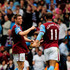 James Milner of Aston Villa celebrates victory with Gabriel Agbonglahor during the Barclays Premiership match between Aston Vilaa and Birmingham City at Villa Park on April 25, 2010 in Birmingham, England.