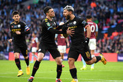 Sergio Aguero of Manchester City celebrates with teammate Phil Foden after scoring his team's first goal during the Carabao Cup Final between Aston Villa and Manchester City at Wembley Stadium on March 01, 2020 in London, England.