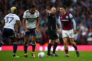 Jack Grealish of Aston Villa reacts after being fouled by Ryan Shotton of Middlesbrough as Referee Mike Dean looks on during the Sky Bet Championship Play Off Semi Final second leg match between Aston Villa and Middlesbrough at Villa Park on May 15, 2018 in Birmingham, England.