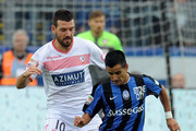(L-R) Andrea Lazzari of Carpi FC competes for the ball with Maximiliano Lopez of Atalanta BCduring the Serie A match between Atalanta BC and Carpi FC at Stadio Atleti Azzurri d'Italia on October 18, 2015 in Bergamo, Italy.