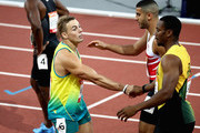 Yohan Blake of Jamaica, Trae Williams of Australia and Adam Gemili of England shake hands after the Men's 100 metres semi finals on day four of the Gold Coast 2018 Commonwealth Games at Carrara Stadium on April 8, 2018 on the Gold Coast, Australia.