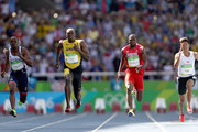 James Dasaolu of Great Britain, Usain Bolt of Jamaica and Richard Thompson of Trinidad and Tobago compete in round one of the Men's 100 Meters on Day 8 of the Rio 2016 Olympic Games at the Olympic Stadium on August 13, 2016 in Rio de Janeiro, Brazil.