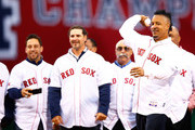 Former Boston Red Sox player and current player/coach for the Triple-A Iowa Cubs throws out the first pitch prior to the game between the Boston Red Sox and Atlanta Braves at Fenway Park on May 28, 2014 in Boston, Massachusetts. The pregame ceremony commemorated the 2004 World Series Championship Boston Red Sox team.