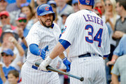 Rene Rivera #7 of the Chicago Cubs is congratulated by Jon Lester #34 after hitting a grand slam against the Atlanta Braves during the second inning at Wrigley Field on September 2, 2017 in Chicago, Illinois.