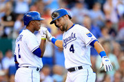Alex Gordon #4 of the Kansas City Royals is congratulated by Alcides Escobar #2 after hitting a home run during the game against the Atlanta Braves at Kauffman Stadium on June 26, 2013 in Kansas City, Missouri.