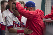 Cesar Hernandez #16 of the Philadelphia Phillies hugs Andres Blanco #4 after scoring a run in the bottom of the sixth inning against the Atlanta Braves at Citizens Bank Park on May 22, 2016 in Philadelphia, Pennsylvania. The Phillies defeated the Braves 5-0.