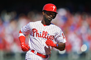 Andrew McCutchen #22 of the Philadelphia Phillies rounds the bases after hitting a home run in the first inning against the Atlanta Braves on Opening Day at Citizens Bank Park on March 28, 2019 in Philadelphia, Pennsylvania.