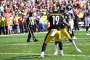 JuJu Smith-Schuster #19 of the Pittsburgh Steelers celebrates with Antonio Brown #84 after an 18-yard touchdown reception in the first quarter during the game against the Atlanta Falcons at Heinz Field on October 7, 2018 in Pittsburgh, Pennsylvania.