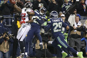Wide receiver Mohamed Sanu #12 of the Atlanta Falcons brings in a touchdown pass against cornerback Justin Coleman #28 of the Seattle Seahawks and Earl Thomas #29 in the first quarter of the game at CenturyLink Field on November 20, 2017 in Seattle, Washington.