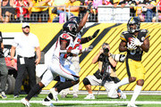 Antonio Brown #84 of the Pittsburgh Steelers makes a catch for a 47-yard touchdown reception in front of Damontae Kazee #27 and Robert Alford #23 of the Atlanta Falcons in the second half during the game at Heinz Field on October 7, 2018 in Pittsburgh, Pennsylvania.