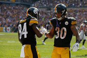 Antonio Brown #84 of the Pittsburgh Steelers celebrates with James Conner #30 after a 9 yard touchdown reception in the second half during the game against the Atlanta Falcons at Heinz Field on October 7, 2018 in Pittsburgh, Pennsylvania.