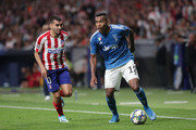Alex Sandro of Juventus competes for the ball with Angel Martin Correa (L) of Atletico de Madrid the UEFA Champions League group D match between Atletico Madrid and Juventus at Wanda Metropolitano on September 18, 2019 in Madrid, Spain.