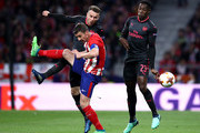 Gabi of Atletico Madrid is tackled by Aaron Ramsey of Arsenal as Danny Welbeck of Arsenal looks on during the UEFA Europa League Semi Final second leg match between Atletico Madrid  and Arsenal FC at Estadio Wanda Metropolitano on May 3, 2018 in Madrid, Spain.