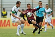 Bady of Atletico-PR competes for the ball with Chico of Coritiba during the match between Atletico-PR and Coritiba for the Brazilian Series A 2014 at Willie Davids stadium on May 25, 2014 in Maringa, Brazil.