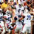Michael Dyer Photos - Michael Dyer #5 of the Auburn Tigers celebrates with teammates after scoring a touchdown against the Clemson Tigers during their game at Memorial Stadium on September 17, 2011 in Clemson, South Carolina. - Auburn v Clemson