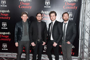Matthew Followill, Nathan Followill, Jared Followill and Caleb Followill of Kings of Leon attend the 'August: Osage County' premiere at Ziegfeld Theater on December 12, 2013 in New York City.