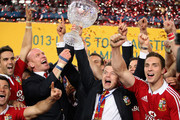 Brian O'Driscoll (R) and Paul O'Connell of the Lions raise Tom Richards Cup after their victory during the International Test match between the Australian Wallabies and British & Irish Lions at ANZ Stadium on July 6, 2013 in Sydney, Australia.