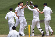 James Anderson (L) of England celebrates his dismissal of David Warner of Australia with Jonny Bairstow during day two of the Fourth Ashes Test Match between Australia and England at Melbourne Cricket Ground on December 27, 2013 in Melbourne, Australia.