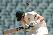 Shane Watson of Australia ducks after receiving a bouncer from Varun Aaron of India during day one of the First Test match between Australia and India at Adelaide Oval on December 9, 2014 in Adelaide, Australia.