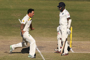 Mitchell Johnson of Australia celebrates the dismissal of Varun Aaron of Inida during day five of the First Test match between Australia and India at Adelaide Oval on December 13, 2014 in Adelaide, Australia.