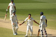 Mitchell Johnson of Australia celebrates after he took the wicket of Varun Aaron of India during day five of the First Test match between Australia and India at Adelaide Oval on December 13, 2014 in Adelaide, Australia.