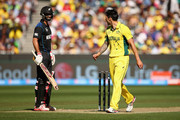 Grant Elliott of New Zealand and Mitchell Johnson of Australia exchange words during the 2015 ICC Cricket World Cup final match between Australia and New Zealand at Melbourne Cricket Ground on March 29, 2015 in Melbourne, Australia.
